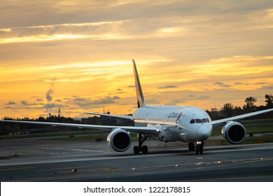 New York, New York - October 26, 2018 : A LATAM airplane getting ready to depart from JFK airport during a sunrise.