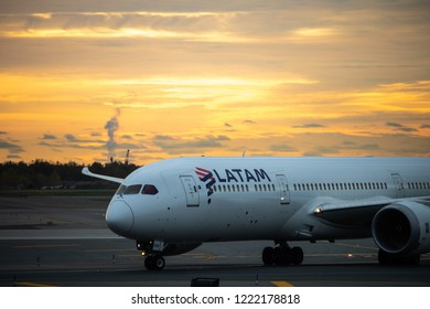 New York, New York - October 26, 2018 : A LATAM airplane getting ready for departure from JFK airport during a sunrise.