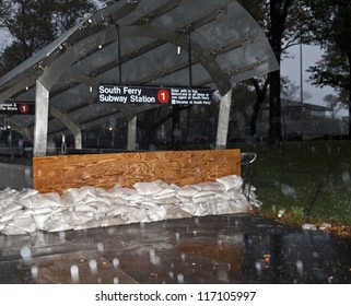 NEW YORK - OCTOBER 29: Entrance to South Ferry subway station in New York boarded with plywood and sand bags in preparation for hurricane Sandy on October 29, 2012 in New York City