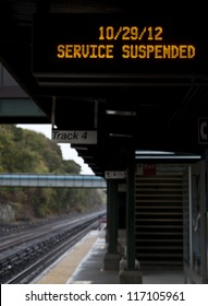 NEW YORK - OCTOBER 29: Riverdale station of Metro-North sign informing that railroad service is suspended in preparation for hurricane Sandy on October 29, 2012 in New York City