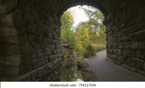 New York, New York - October 30, 2017: A scenic autumn view of an arch tunnel in Central Park in Manhattan, New York on October 30, 2017.