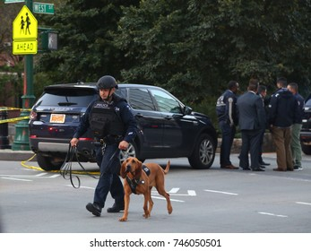 NEW YORK - OCTOBER 31, 2017: NYPD emergency service unit police officer with K-9 dog  at the crime scene near a terror attack site in lower Manhattan in New York.