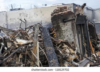 NEW YORK - October 31: Homes sit smoldering after Hurricane Sandy on October 30; 2012 in the Far Rockaway area  on October 30; 2012 in New York City; NY