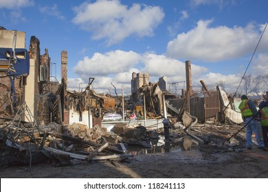 NEW YORK - October 31: Homes sit smoldering after Hurricane Sandy  in the Far Rockaway area  on October 30; 2012 in New York City; NY