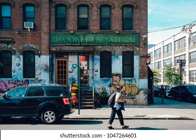 NEW YORK - OCTOBER 4: A Bushwick street on October 4th, 2017 in Bushwick Brooklyn. Bushwick's major commercial streets are Knickerbocker Avenue, Myrtle Avenue, Wyckoff Avenue, and Broadway.