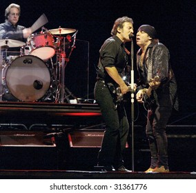 NEW YORK - OCTOBER 4: Singer Bruce Springsteen (C), Steve Van Zandt (R) and Max Weinberg, of the E Street Band, perform their last show for the 2002-03 World Tour at Shea Stadium October 4, 2003 in Flushing, New York.