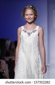 b308627ed146 NEW YORK - OCTOBER 5: Girl walks runway for RUUM American Kid's Wear  Swarovski collection