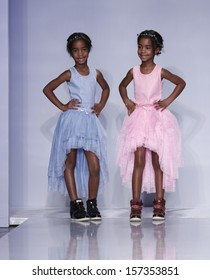 NEW YORK - OCTOBER 5: Jesse Combs, D'Lila Combs walk runway for Ooh! La! La! Couture Swarovski collection at Vogue Bambini petiteParade Kids Fashion Week at Industrial Superstudio on Oct 5 2013 in NYC