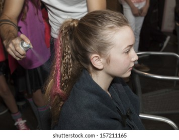 NEW YORK - OCTOBER 6: unidentified Girl prepares backstage at Vogue Bambini petiteParade Kids Fashion Week at Industrial Superstudio on October 6, 2013 in New York City