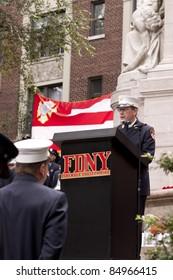NEW YORK - SEPT 11, 2011: FDNY Chaplain Reverend Stephen Harding speaks at the 10TH anniversary remembrance ceremony at the Firefighters Memorial in Riverside Park on September 11, 2011 in New York.