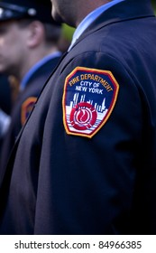 NEW YORK - SEPT 11: A close up view of a Firefighters badge during a ceremony at the Firefighters Memorial on September 11, 2011 in New York. Firefighters from around the world attended the ceremony.