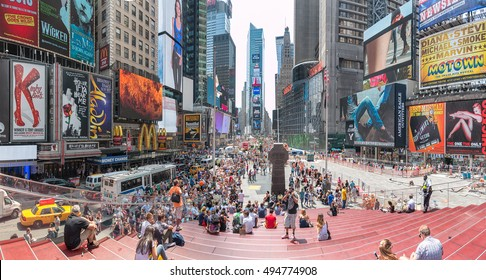 New York - Sept 2014: Tourists relax and enjoy the view of the busy streets of 42nd Street, Times Square on Sept 20, 2014 in New York, USA.