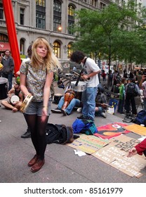 NEW YORK - SEPT. 21:A young woman plays tambourine amid the Occupy Wall Street demonstration near the New York Stock Exchange on September 21, 2011 in New York City