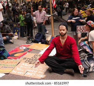 NEW YORK - SEPT. 21:A young man meditates amid the Occupy Wall Street demonstration near the New York Stock Exchange on September 21, 2011 in New York City.