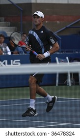 NEW YORK - SEPT 3: Bryan of USA waits for the ball during 1st round doubles match against Jose Acasuso and Martin Arguello of Argentina at US Open on September 3, 2009 in New York.