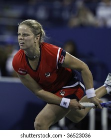 NEW YORK - SEPT 4: Kim Clijsters of Belgium returns a shot during 2nd round match against Kristen Flipkens of Belgium at US Open on September 4 2009 in New York