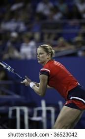 NEW YORK - SEPT 4: Kim Clijsters of Belgium returns a shot during 2nd round match against Kristen Flipkens of Belgium at US Open on September 4 2009 in New York