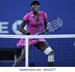 NEW YORK - SEPT 4: Venus Williams of USA returns a shot during 2nd round match against Magdalena Rybarikova of Slovakia at US Open on September 4 2009 in New York