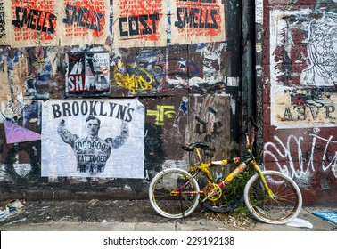 NEW YORK - SEPT 8  2012: Bicycle parked in front of Flyposting and graffiti covered wall in west Williamsburg, Brooklyn. Williamsburg has become known as an arts and culture mecca in New York city.