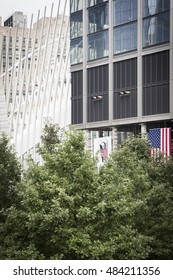 NEW YORK - SEPT 9 2016: The American Flag hangs from Tower 3 building at Three World Trade Center still under construction being built next to Tower 4 on the 15th anniversary of the terrorist attacks.