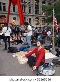 NEW YORK - SEPT.: A young man meditates amid the Occupy Wall Street demonstration near the New York Stock Exchange on September 21, 2011 in New York City.