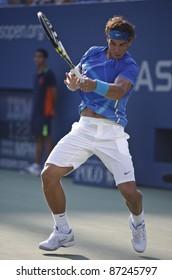 NEW YORK - SEPTEMBER 02: Rafael Nadal of Spain returns ball during 2nd round match against Nicolas Mahut of France at USTA Billie Jean King National Tennis Center on September 02, 2011 in New York City, NY