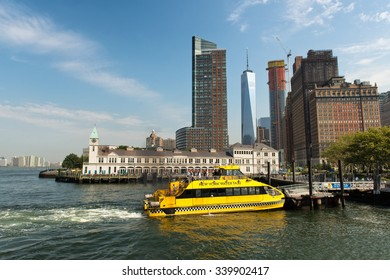 NEW YORK - SEPTEMBER 02: Yellow Water Taxi Tour Boat Docked at Pier Along Waterfront at New York City Boat Terminal, New York, USA. September 02, 2015.