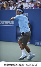 NEW YORK - SEPTEMBER 04: Roger Federer of Switzerland returns a ball during match against Paul-Henry Mathieu of France at US Open Tennis Championship on September 04, 2010 in New York, City.