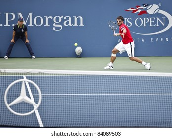 NEW YORK - SEPTEMBER 05: Janko Tipsarevic of Serbia returns ball during 4th round match against Juan Carlos Ferrero of Spain at USTA Billie Jean King National Tennis Center on September 05 2011 in NYC
