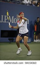 NEW YORK - SEPTEMBER 05: Svetlana Kuznetsova of Russia returns ball during 4th round match against Caroline Wozniacki of Denmark at USTA Billie Jean King National Tennis Center on Sep 05, 2011 in NYC