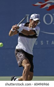 NEW YORK - SEPTEMBER 06: Novak Djokovic returns the ball during fourth round match against Mardy Fish of USA at US Open tennis tournament on September 06, 2010, New York.