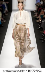 NEW YORK - SEPTEMBER 09: A model is walking the runway at Carolina Herrera Collection for Spring Summer 2014 fashion show during Mercedes-Benz Fashion Week on SEPTMEBR 09, 2013 in New York