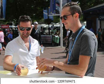 NEW YORK -SEPTEMBER 1, 2018: Tennis enthusiasts make Champagne toast at Billie Jean King National Tennis Center during 2018 US Open. Moet and Chandon is the official champagne of the US Open