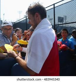 NEW YORK - SEPTEMBER 10, 2016: Grand Slam champion Stanislas Wawrinka of Switzerland signs autographs after practice for US Open 2016 at Billie Jean King National Tennis Center