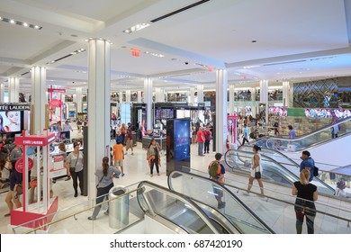 NEW YORK - SEPTEMBER 10: Macy's department store interior, cosmetics area with escalators on September 10, 2016 in New York. Macy is the largest U.S. department store company.