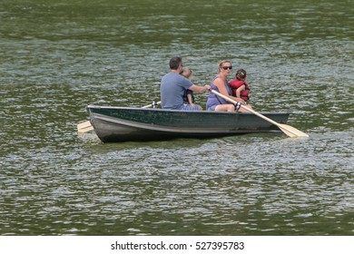 New York, September 11, 2016: A family is boating in Central Park.