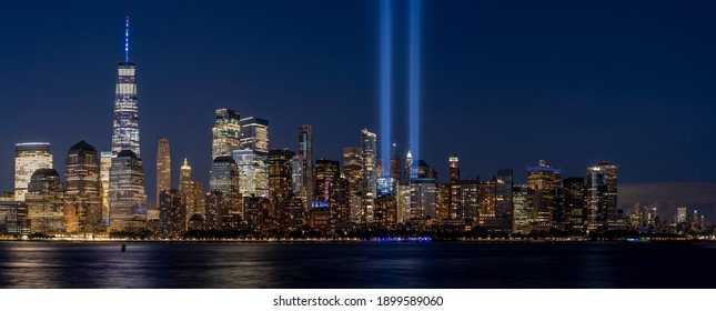 New York, New York - September 11, 2020: A view of the memorial lights rising above the lower Manhattan Island cityscape.