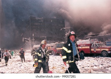NEW YORK - SEPTEMBER 11: New York City firefighters walk near the area known as Ground Zero after the collapse of the Twin Towers on September 11, 2001 in New York City.