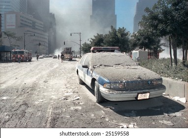 NEW YORK - SEPTEMBER 11:  A Port Authority police vehicle lies covered with ash near the area known as Ground Zero after the collapse of the Twin Towers September 11, 2001 in New York City.