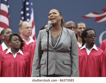 NEW YORK - SEPTEMBER 11: Queen Latifa preforms on court during 9/11 ceremony at USTA Billie Jean King National Tennis Center on September 11, 2011 in NYC
