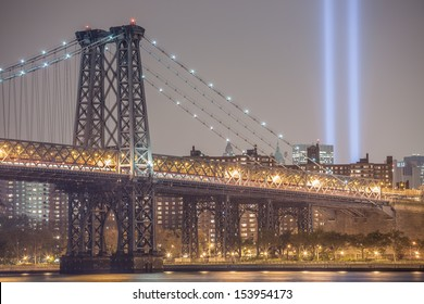 NEW YORK - SEPTEMBER 11: Williamsburg on September 11, 2013. The Tribute in Light memorial creates two vertical columns of light in remembrance of the September 11 attacks