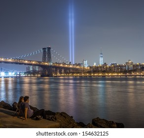 NEW YORK - SEPTEMBER 11: Williamsburg waterfront on September 11, 2013. The Tribute in Light memorial shines bright in remembrance of the terrorist attacks that took place on September 11, 2001