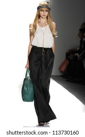 NEW YORK - SEPTEMBER 12: A model walks the runway at the RACHEL ZOE Spring/Summer 2013 collection Mercedes-Benz Fashion Week in New York on September 12, 2012