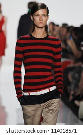 NEW YORK - SEPTEMBER 12: Model walks the runway at the Michael Kors S/S 2013 collection presentation during Mercedes-Benz Fashion Week on September 12, 2012 in New York.