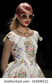 NEW YORK - SEPTEMBER 12: Model Frida walks the runway at the Anna Sui Spring Summer 2013 Collection presentation during Mercedes-Benz Fashion Week on September 12, 2012 at Lincoln Center in New York