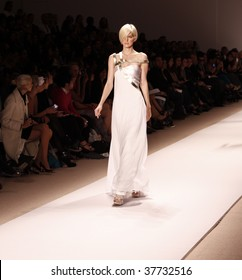 NEW YORK - SEPTEMBER 12: A model walks the runway at Edition by Georges Chakra Collection for Spring/Summer 2010 during Mercedes-Benz Fashion Week on September 12, 2009 in New York.