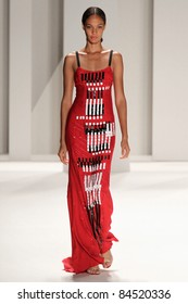 NEW YORK - SEPTEMBER 12: Model Joan Smalls walks the runway at the Carolina Herrera S/S 2012 collection presentation during Mercedes-Benz Fashion Week on September 12, 2011 in New York.