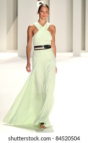 NEW YORK - SEPTEMBER 12: Model  Karmen Pedaru walks the runway at the Carolina Herrera S/S 2012 collection presentation during Mercedes-Benz Fashion Week on September 12, 2011 in New York.