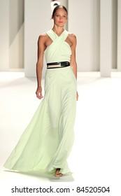 NEW YORK - SEPTEMBER 12: Model  Karmen Pedaru walks the runway at the Carolina Herrera S/S 2012 collection presentation during Mercedes-Benz Fashion Week on September 12, 2011 in New York.