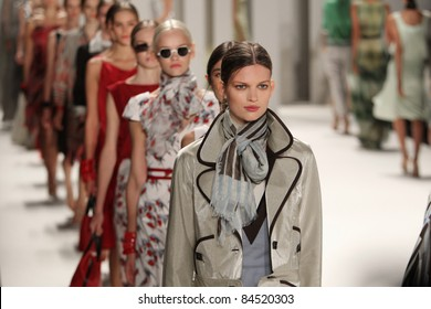 NEW YORK - SEPTEMBER 12: Models walk the runway at the Carolina Herrera S/S 2012 collection presentation during Mercedes-Benz Fashion Week on September 12, 2011 in New York.